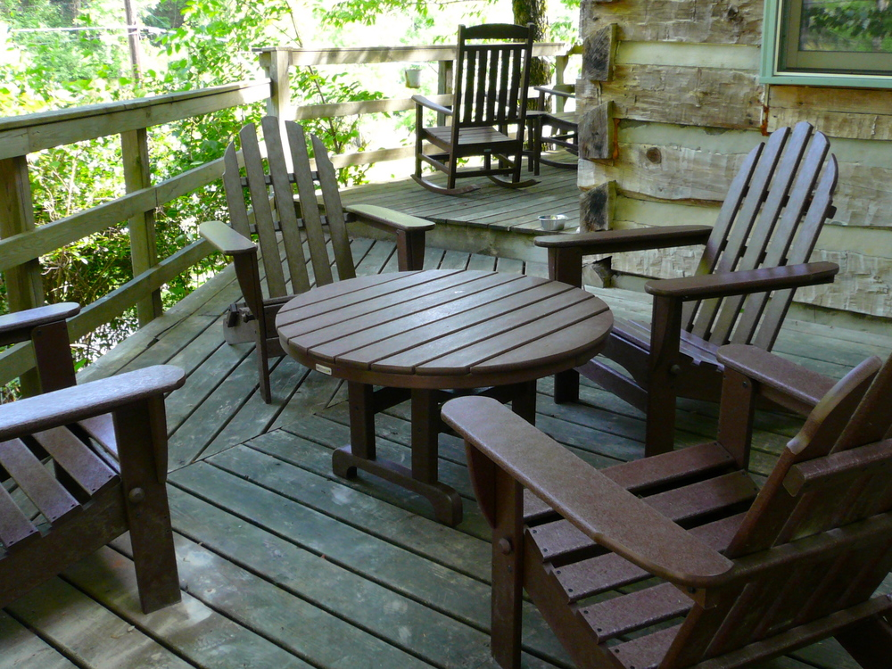 New deck furniture - Two rocking chairs, one small table, four adirondack chairs, and a large table