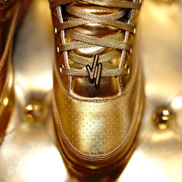 teyana-taylor-packer-shoes-ewing-33-hi-gold-medal.png
