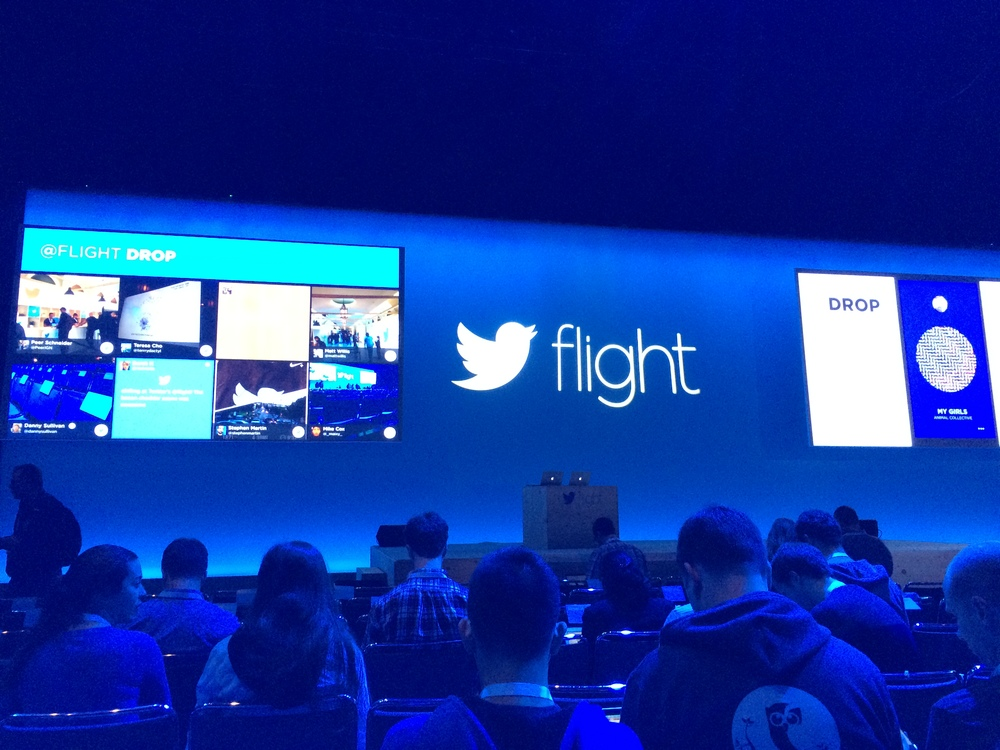Pre-keynote. Twitter had people use Jawbone Drop to select the music playlist. They also grabbed tweets and put them up for all to see. We wondered if it was pulling all tweets with the #twitterflight hashtag, but ultimately decided they were curating the list.