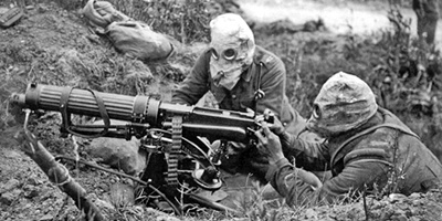 WWI machine gun crew wearing gas masks