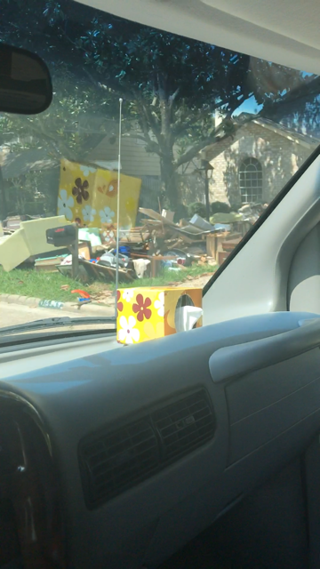 The neighborhoods had piles of flood damaged goods and building material.