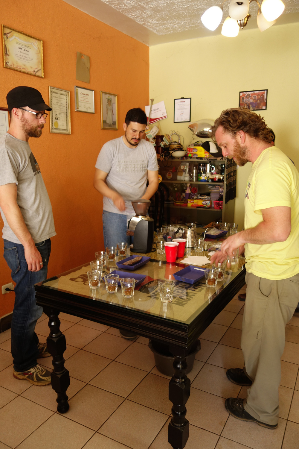 Seth and Edwin of Onyx and Chad of Direct Trade Coffee Club setting up cupping of Huehuetenango producers in home of Aurelio Villatoro.