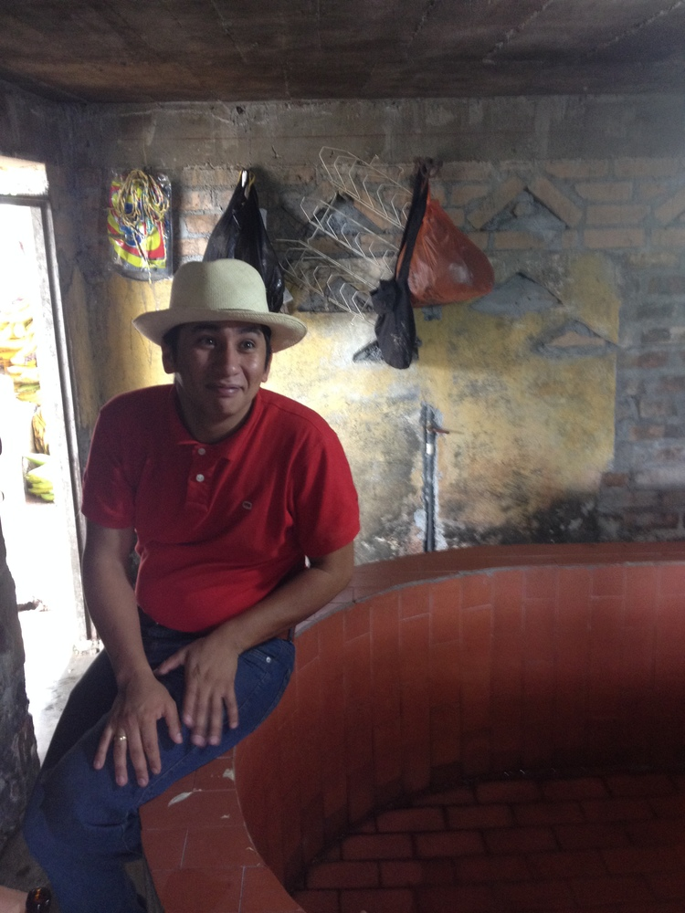 Rodrigo showing us his fermentation tank.  At El Progreso's altitudes and cooler temperatures, the coffee is dry fermented (i.e. not soaking in water) before being washed of the loosened mucilage in the adjoining washing channels (depicted below).
