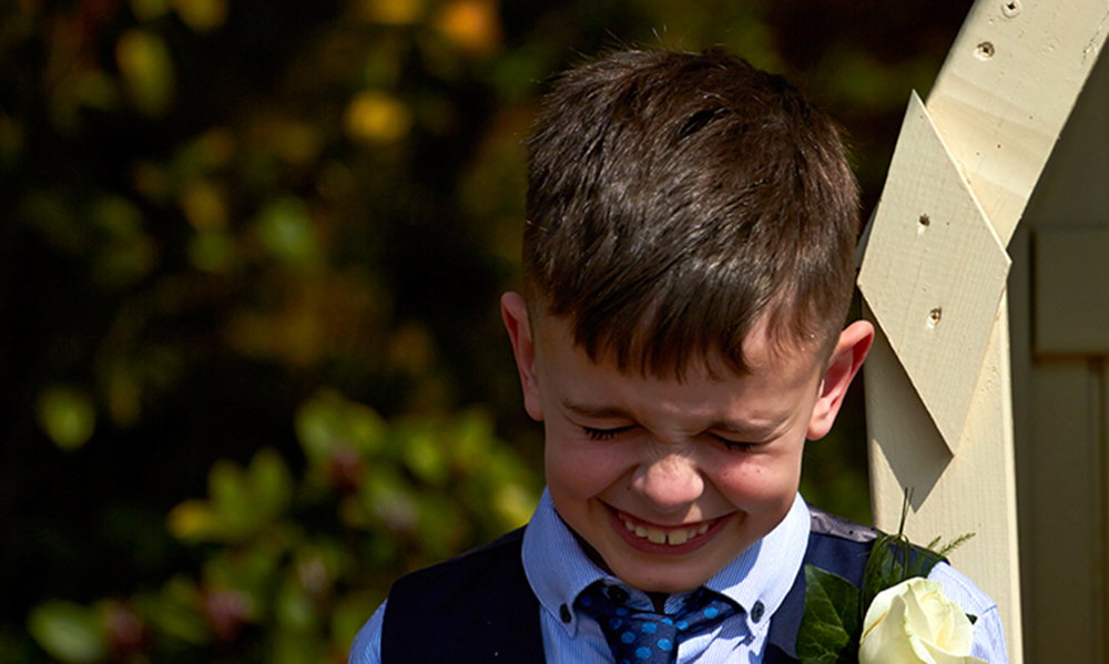 Group wedding photos are important, but so is getting the little cheeky moments