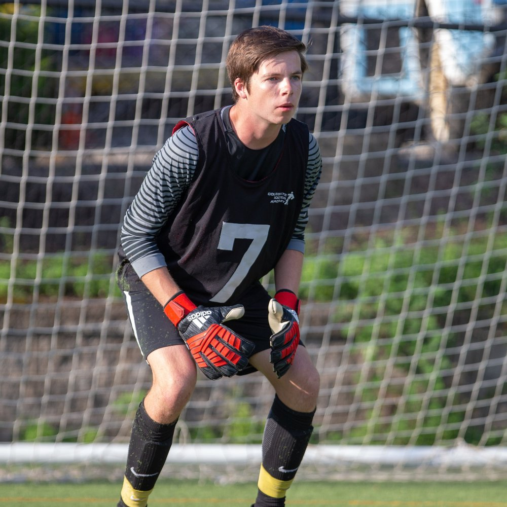 Boy Prepares for shot in soccer camp Massachusetts