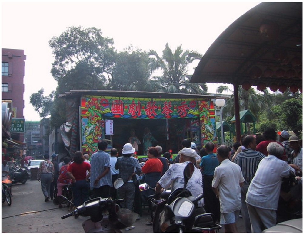 From Yi Yiing Chen: The Taiwanese opera's outdoor setting, a temporary stage next to my grandmother's place.