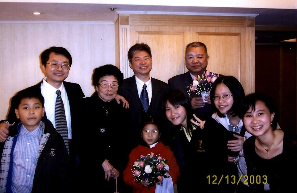 From Yi Yiing Chen:   Back row from the left: my uncle (her 4th son), my ah ma, my dad (her 3rd son), another uncle (her 1st son);   Front row from the left: my brother, my youngest sister, me wearing high school uniform, my younger sister, my mom.