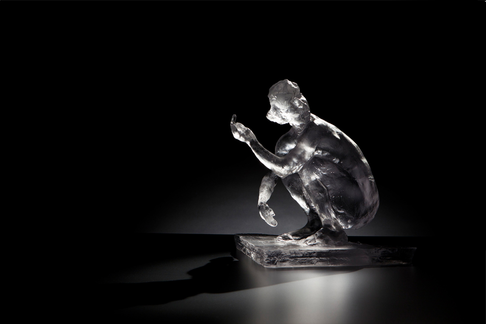 Untitled (Squatting Woman with Raised Arm)  2012 Medium: Glass Dimensions: 13.5 x 11.75 x 10 inches Edition of 10 Arabic Numbers and 2 Artist Proofs