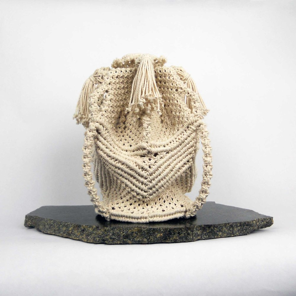 "Chevroned Vessel, 2018, 10"" h x 10"" w x 10"" d, Knotted Cotton on Stone. I have been perfecting my knotting artistry for over 45 years. Working with simple materials such as cotton string and rope, I sculpt each vessel carefully selecting and meticulously tying thousands upon thousands of knots. This labor-intensive technique, the process of making the work, becomes just as important as the resulting form.  There is also a certain intimacy in my knotted work that is borne of the process itself. Each knot is a moment of my time spent in studio, providing structure and bringing a sense of order to the chaotic lengths of string and rope.  The knots I use most in my work are a contemporary form of Macramé. I wrote the book Macramé Today: Contemporary Knotting Projects to teach others the techniques and processes which first inspired me as an artist."