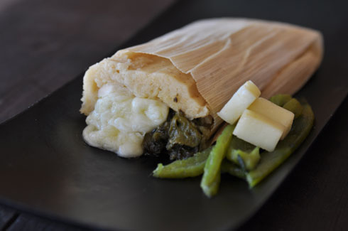 POBLANO CHILES & MONTEREY JACK CHEESE- Similar to the flavor of a chile relleno, this delicious and moderately spicy tamale includes roasted poblano chiles  and a gooey monterey jack cheese center.