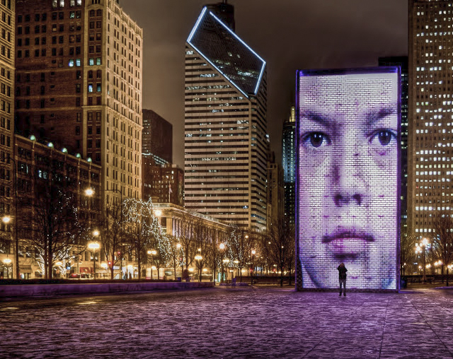 Faces of Chicago in Millennium Park along Michigan Avenue with a person to show how large that face really is.