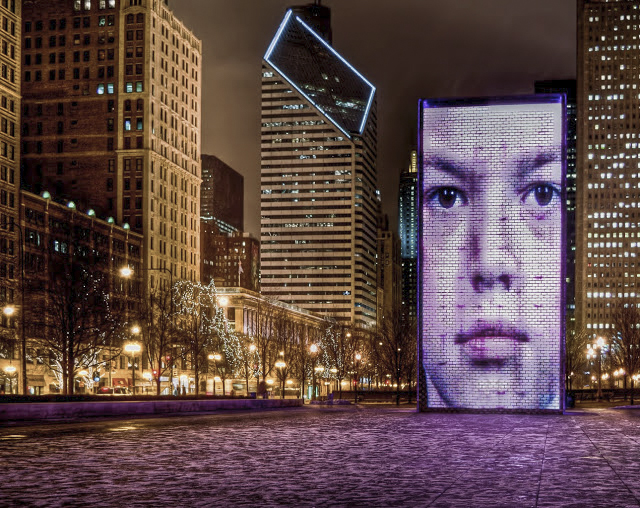 Faces of Chicago in Millennium Park along Michigan Avenue.