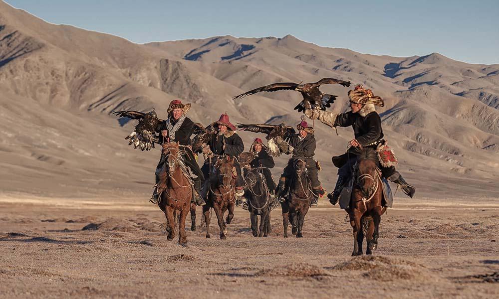 Mongolia Eagle hunters on horseback