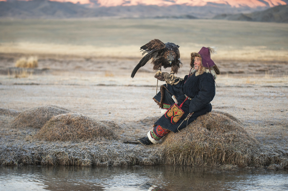 elderly kazakh eagle hunter posing with golden eagle 3.jpg