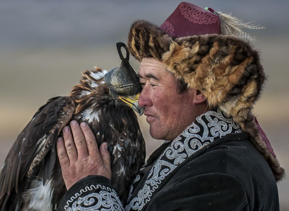 Kazakh Eagle Hunter holds his Golden Eagle