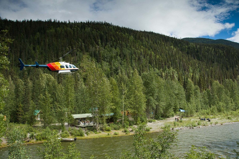 A helicopter landing at our mountain lodge for the grizzly bear portion of our workshop in the BC mountains.