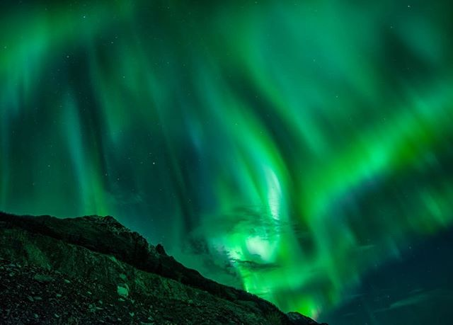 Northern lights sail across the sky's of southern Yukon. Experiences like this make many people awestruck. Once you experience the Aurora it's not something you cross off your bucket list. It's something you want to see again and again. #yesyukon #travelyukon #ohcanada #yukon #northernlights #aurora #canada150 #opcmag