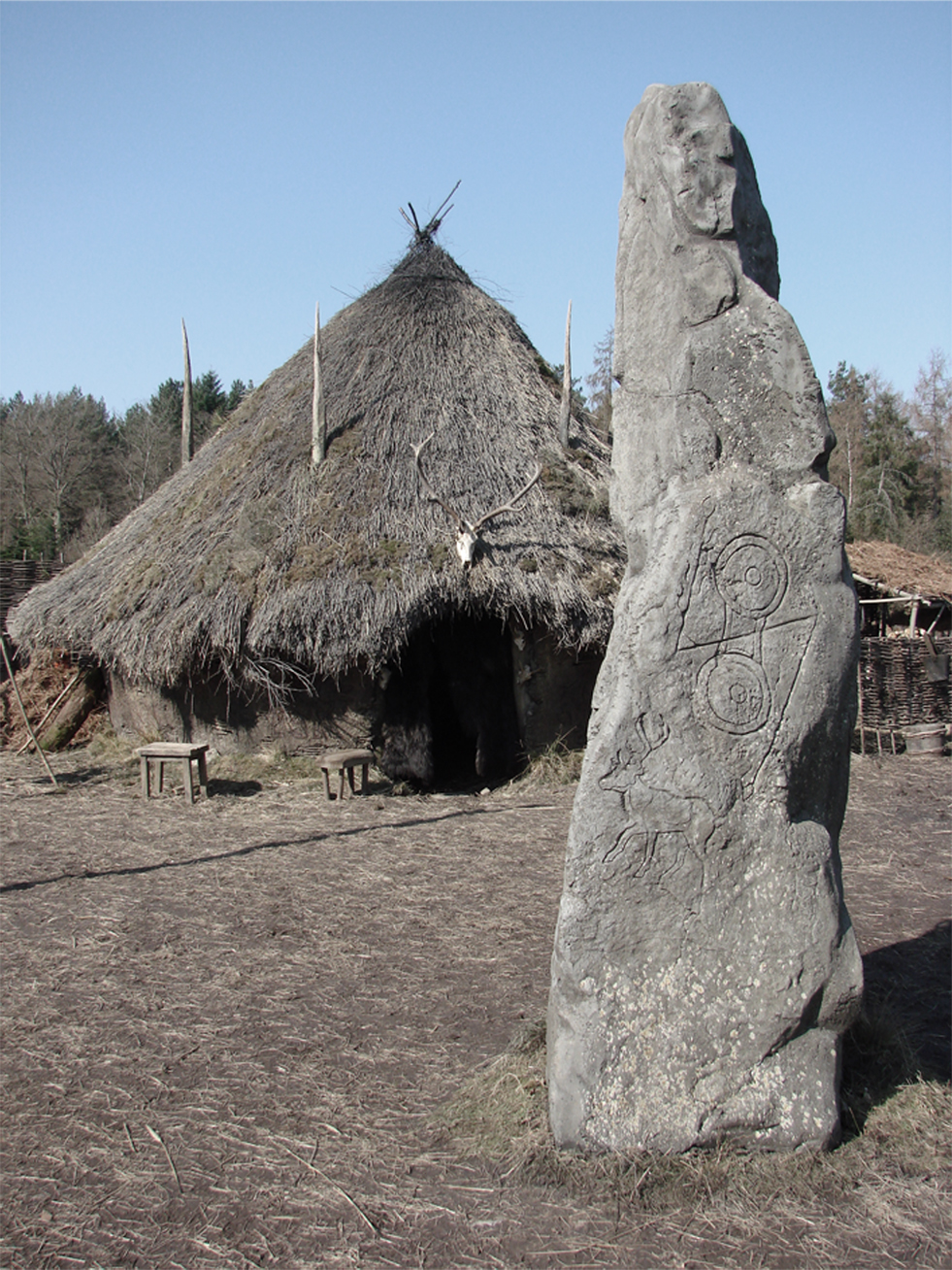 Standing stone decorated with carved Pictish art.
