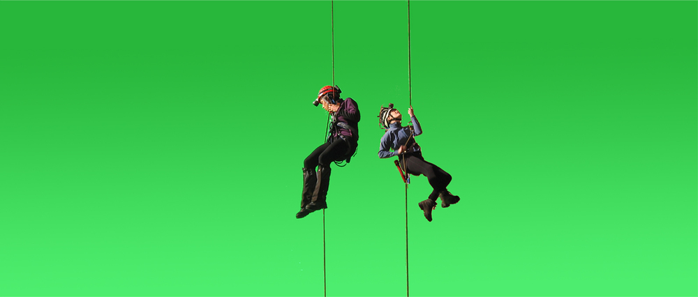 The actresses were shot against green screen as if abseiling down into the cave but actually filmed without being lowered. This footage was then added to the model background plate with the characters descending.