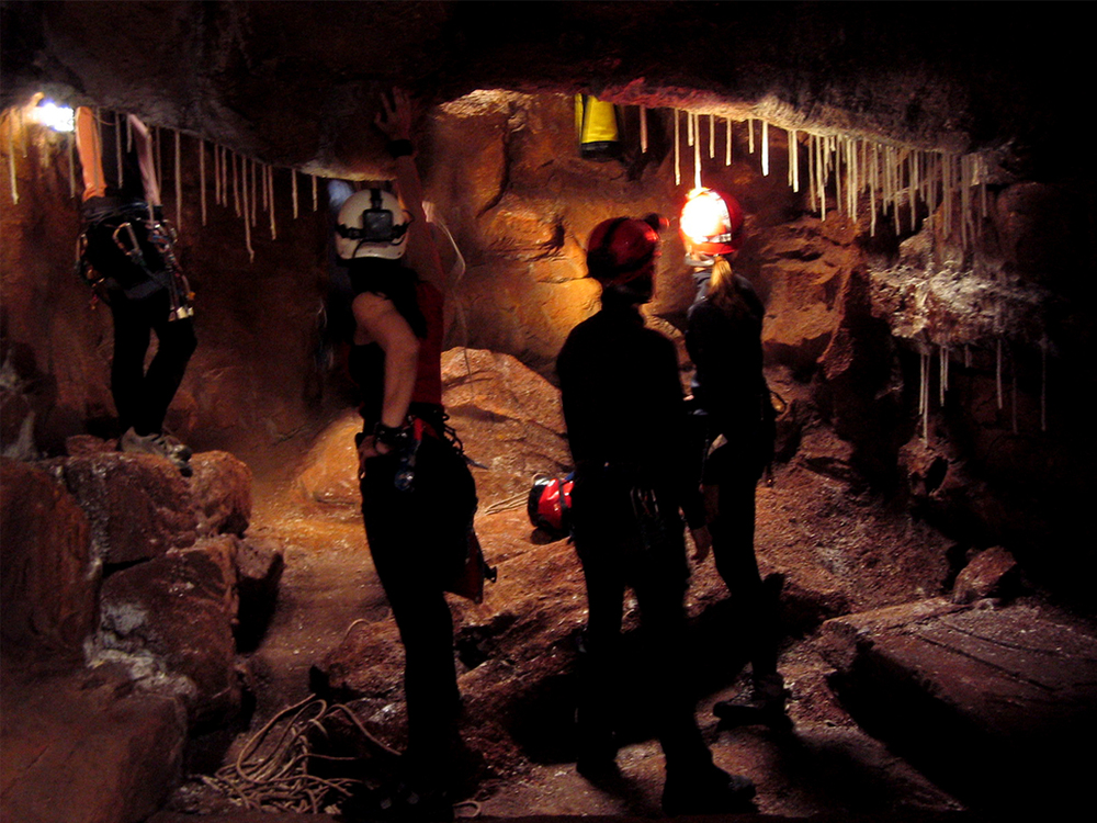 Calcite stalactites were made form dipped wax, glowing when backlit by the characters torches and headlamps.