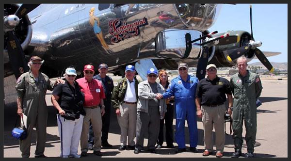 -R: Bob Simon AG-1, Linda Stull, Ed Davidson USAAF, Jay Gates (Co-pilot), Chuck Sweeney USN, Bob Cardenas USAF, Shelby Boelke (Loadmaster), Russ Gilmore (Pilot), Ray Calhoun, USMC, Kevin Bruen USCG.