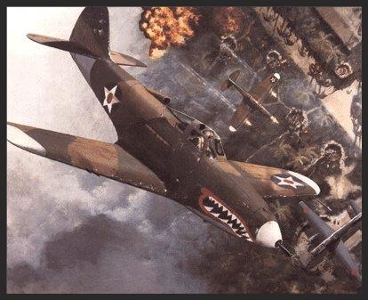 A P-400 (the export version of the P-39 Airacobra) does what it does best: flying down on the deck pounding Japanese ground positions. This P-400 was originally destined for the RAF in the Pacific, but like the others it became part of the 67th Fighter Squadron based at Guadalcanal in 1942. Though it still wears British camouflage, its newly added sharkmouth and American insignia make it clear what unit is dealing out the punishment.