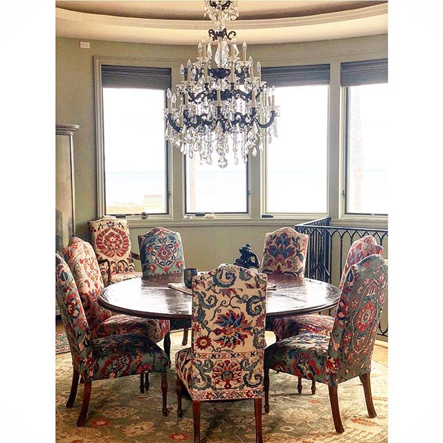 A sneak peek into this eclectic dining room. The various patterns and textures really give a pop of color and character to this coastal home! And look at that ocean view!  #interiordesign #sandiego #diningroom #textiles #crystalchandelier