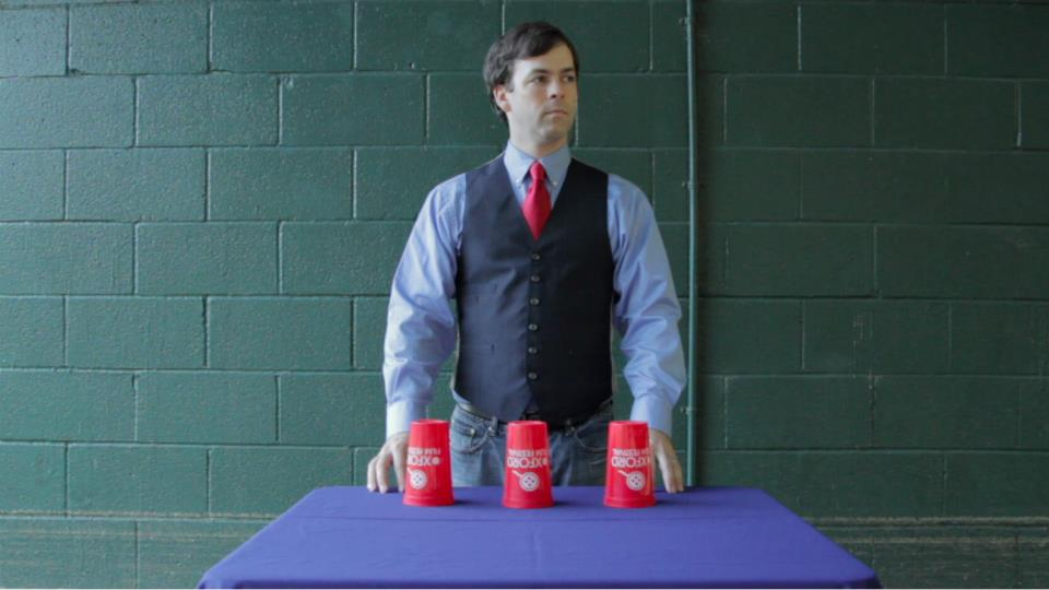 Greg Earnest using festival cups for a shell game in Palindrome (2013)