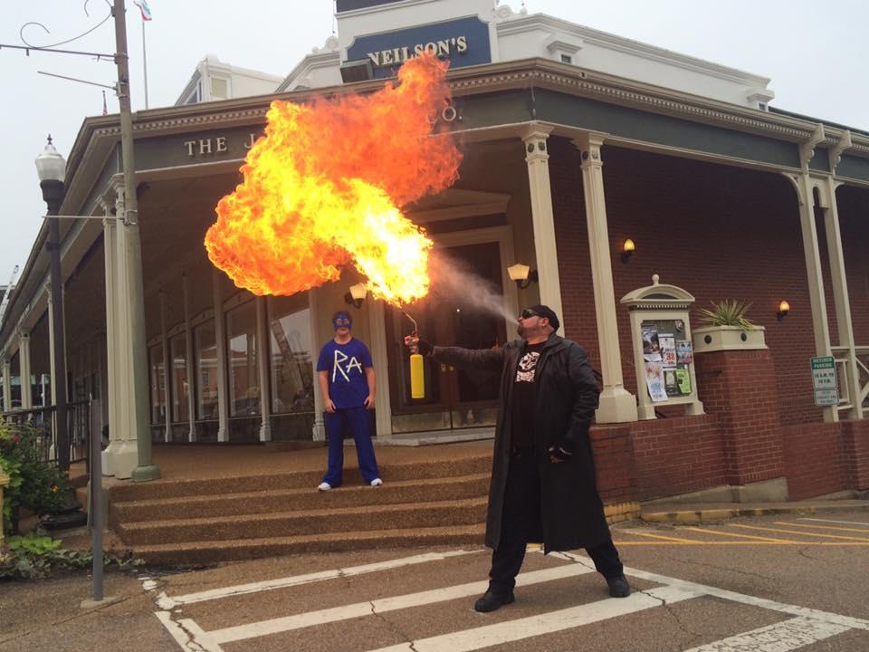 Max McDonaldson blows fire as FireMax. Jake Hall stars as Round About. Photo Courtesy of Melanie Addington