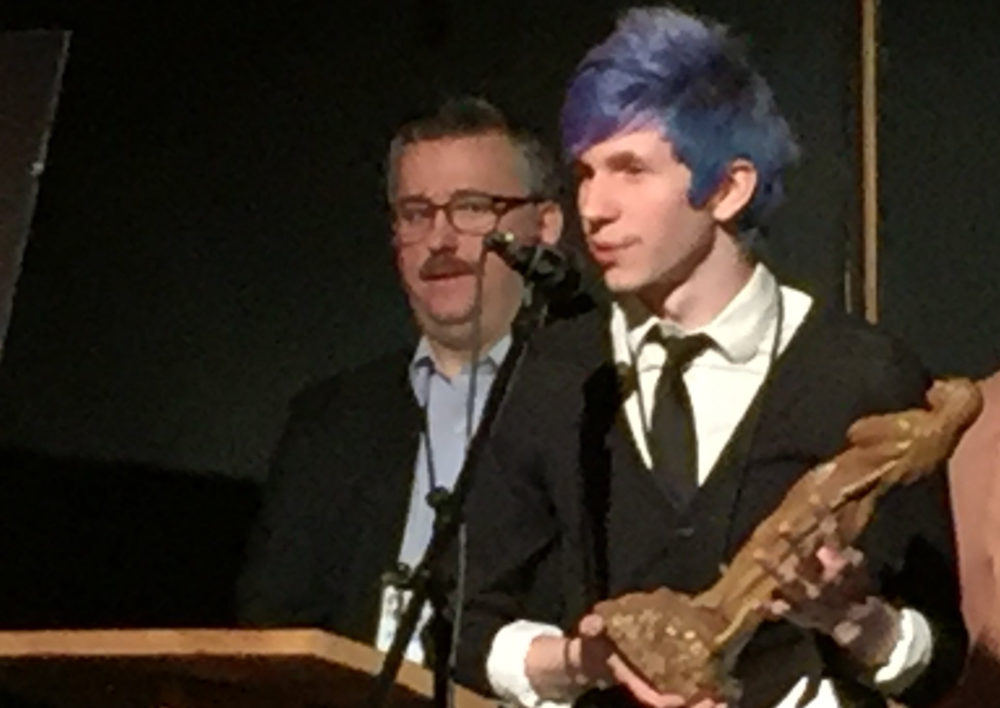 Tyler Byrnes of Breakfast accepts Best Editing Award at Oxford Film Festival.