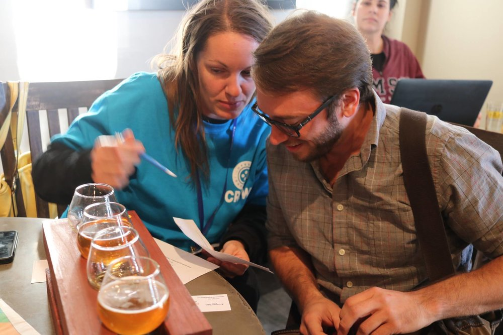 Volunteer Jaime Adams helps a guest during a Whiskey Tasting and screening in 2017.