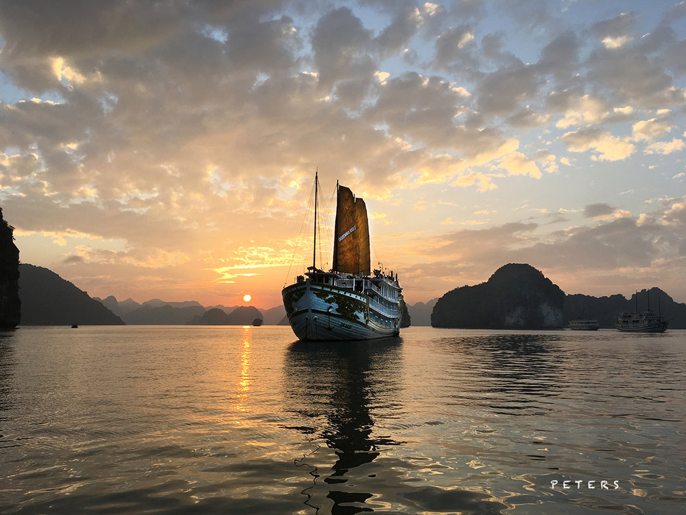 Sunset in Halong Bay Vietnam, a world heritage site. Renown for it's knobby islands and fantastic limestone caves.