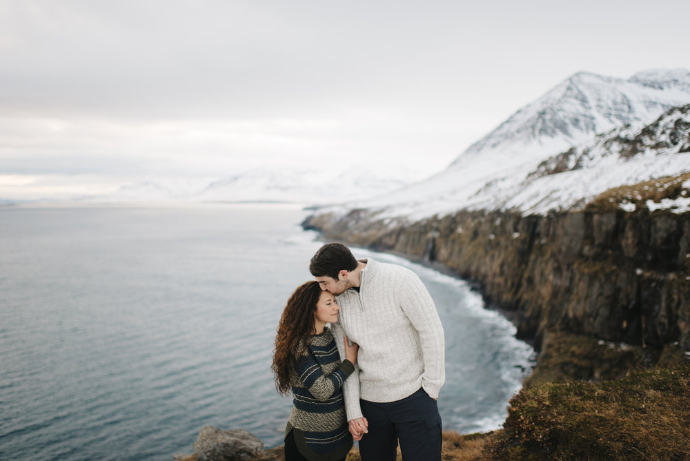 He steals a forehead kiss during Adventure Honeymoon Photography session by Iceland Elopement Photographer Colby and Jess colbyandjess.com