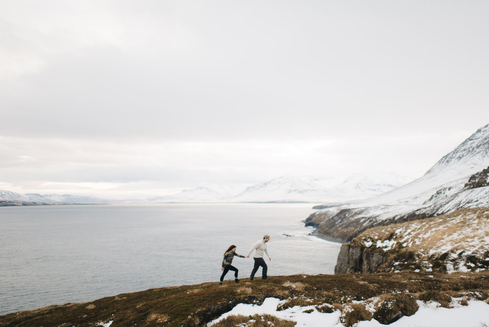 Couple exploring Fjords during Adventure Honeymoon Photography Session by Iceland Elopement Photographer Colby and Jess colbyandjess.com