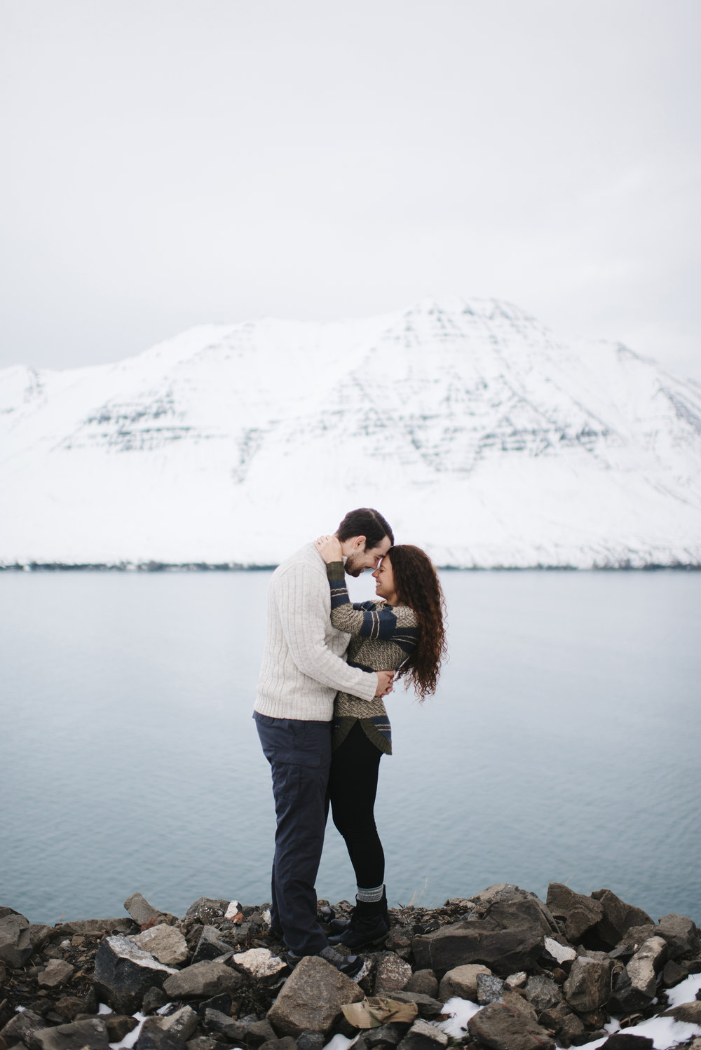 Laughing couple in Fjords of Northeastern Iceland during Honeymoon Photography Session by Iceland Elopement Photographer Colby and Jess colbyandjess.com