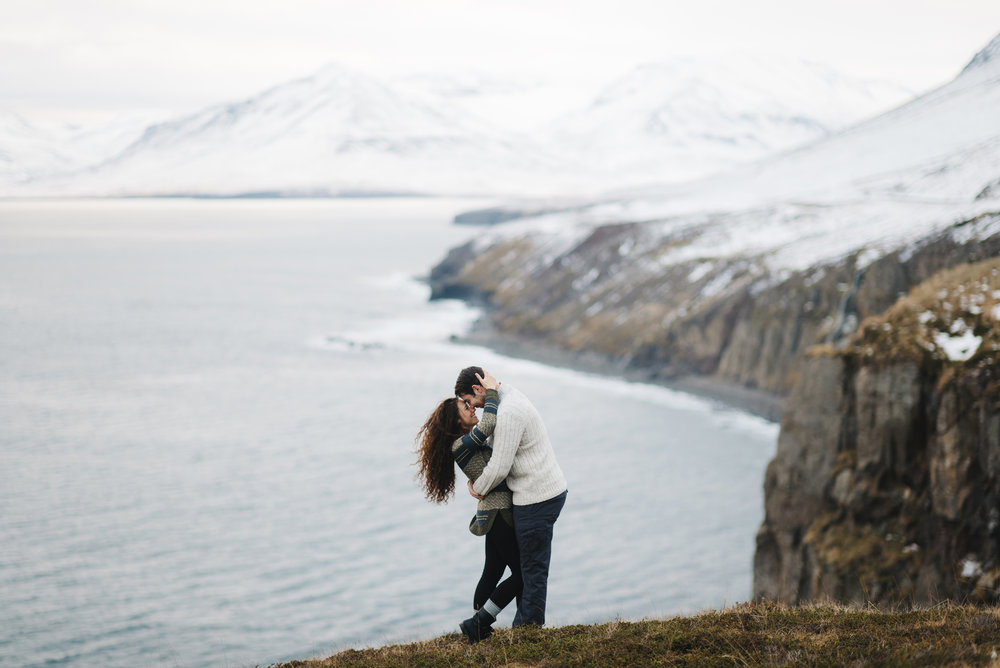 Couple embraces during their honeymoon adventure photography session in the Fjords of North Iceland by Iceland Engagement Photographer Colby and Jess colbyandjess.com
