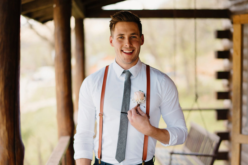 A groom smiles with excitement before his Outdoor Buffalo River Wedding by Arkansas Adventure Destination Wedding Photographer Colby and Jess