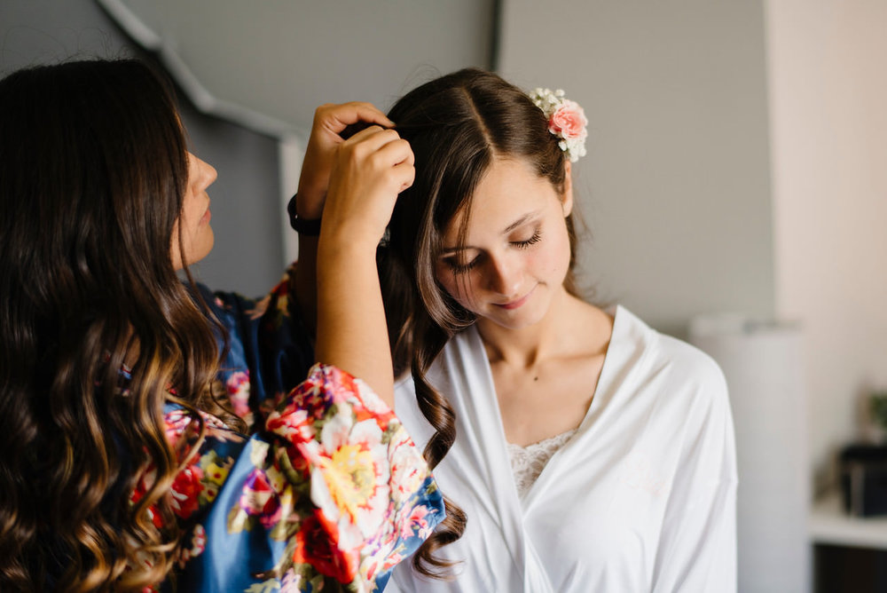 A beautiful bride has her hair done for her Outdoor Ozarks Wedding by Buffalo River Adventure Elopement Photographers Colby and Jess
