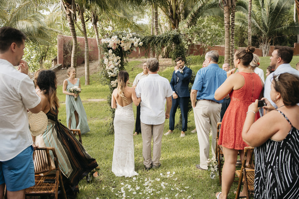 Groom tears up as he sees bride during Sayulita Wedding ceremony photography by Mexico Destination Elopement Photographer Colby and Jess colbyandjess.com