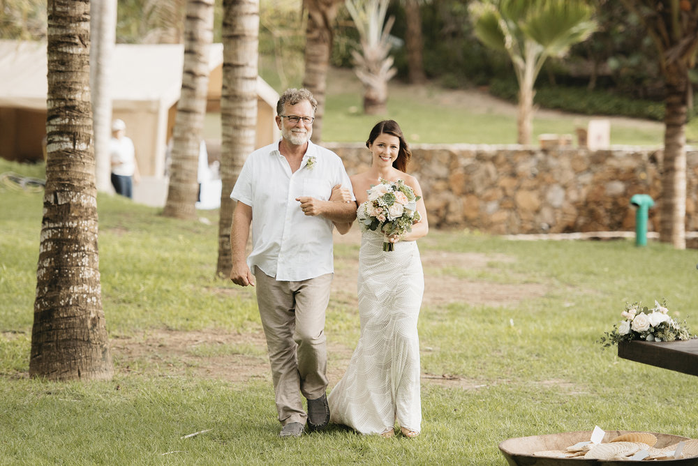 Bride and her father walk down aisle in Sayulita Mexico photography by Puerto Vallarta Wedding Photographer Colby and Jess colbyandjess.com