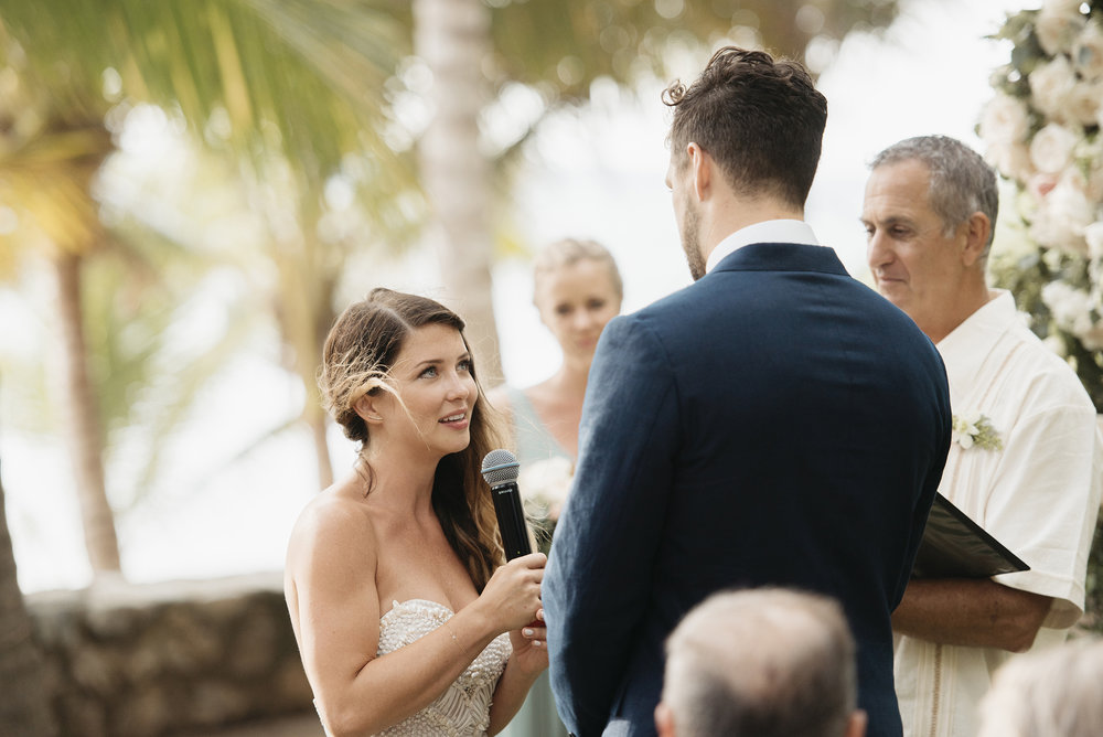 Bride says her vows to groom during Sayulita Ceremony photography by Mexico Destination Photographer Colby and Jess colbyandjess.com