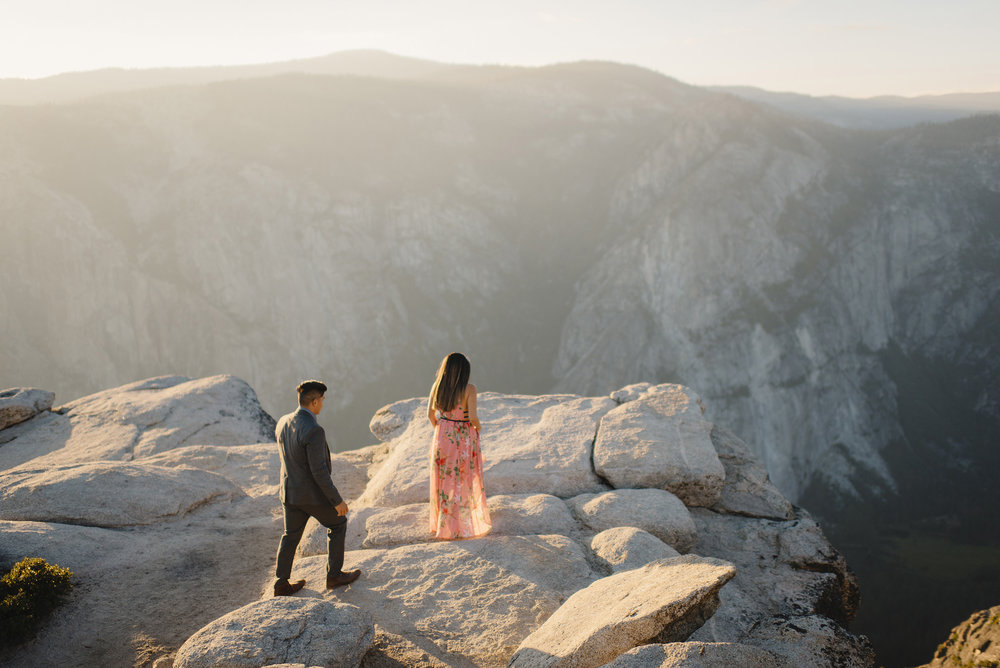 Adventurous couple walking to edge of Taft Point for engagement photography by Yosemite wedding photographer Colby and Jess  colbyandjess.com