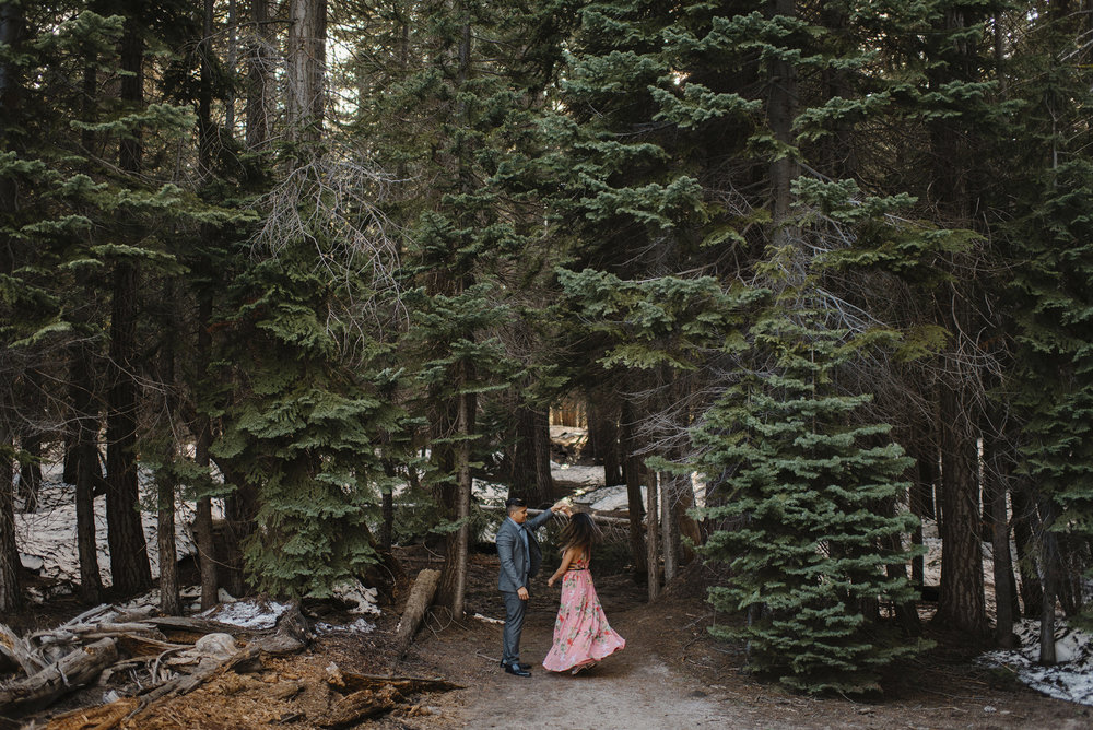 They dance under the redwood trees on the trail to Taft Point.  Romantic Engagement Photography by Yosemite Elopement Photographers Colby and Jess Photography. colbyandjess.com