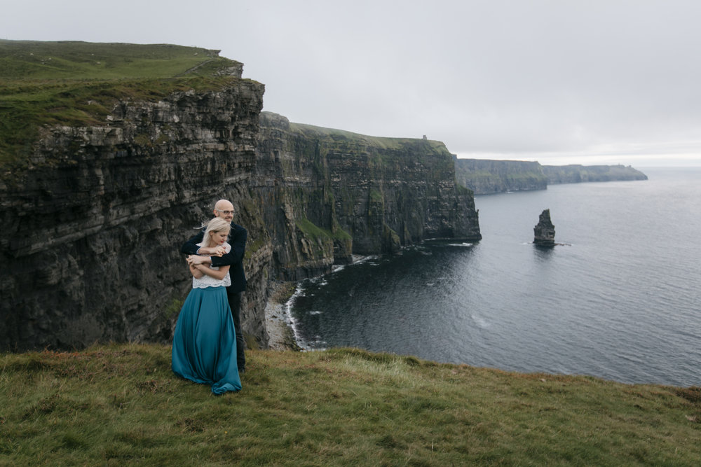Bohemian couple embrace each other during their epic photography session by Cliffs of Moher Elopement photographers Colby and Jess