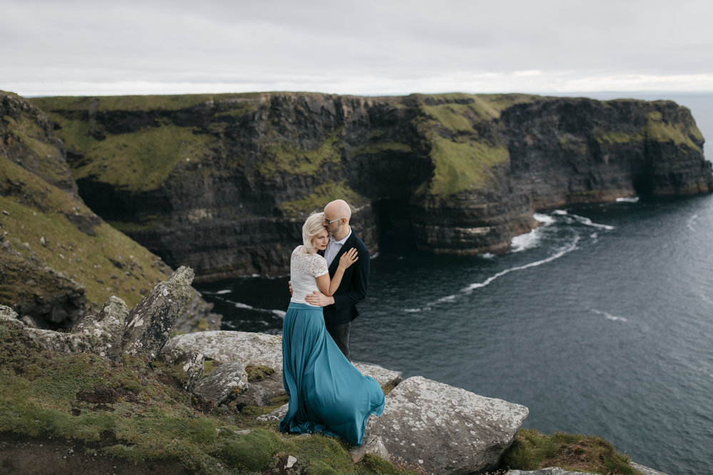 Adventurous man and woman explore Ireland during their anniversary photography session by Cliffs of Moher elopement photographers Colby and Jess