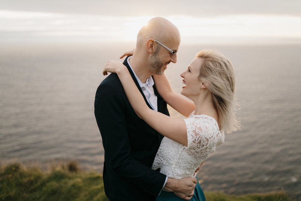 an intimate moment during anniversary session at cliffs of moher by colby and jess adventure wedding photographers