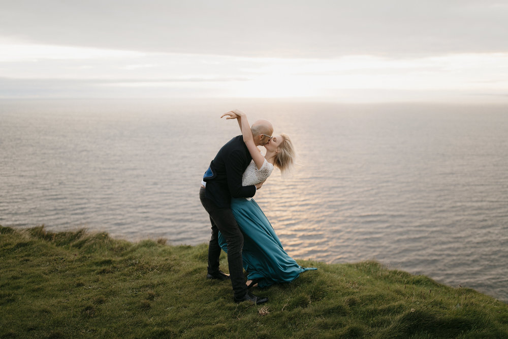 a romantic kiss at cliffs of moher by adventure elopement photographers colby and jess