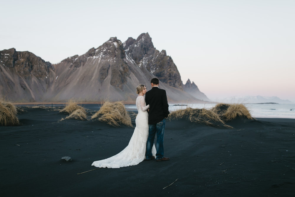 A bride and groom enjoy Vestrahorn during their Iceland Elopement Photography session with Iceland Destination Wedding Photographers Colby and Jess.