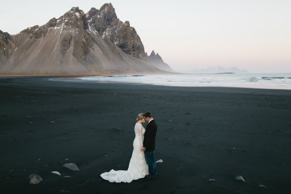 A couple enjoys a quiet moment during their Vestrahorn Iceland Destination Wedding with elopement photographers Colby and Jess.