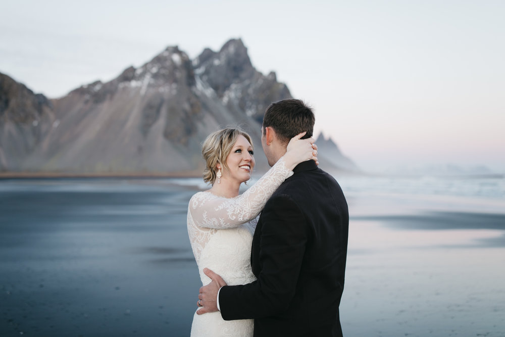 A beautiful bride smiles at her groom during their Iceland Elopement photography session with Colby and Jess.